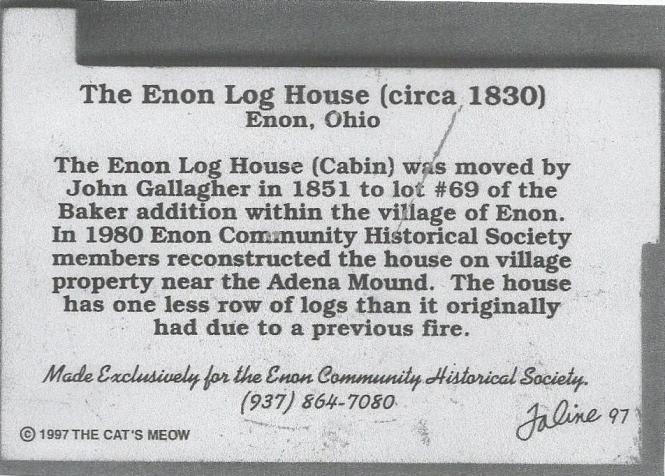 back of log house cat's m